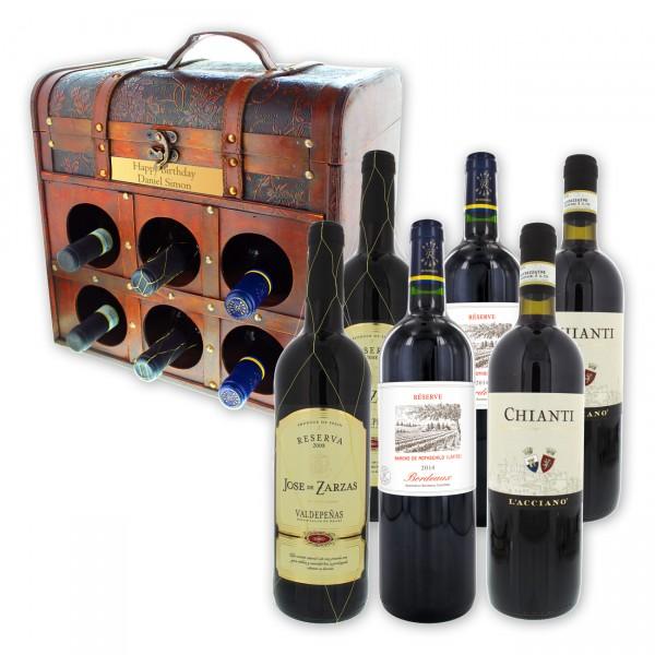 Verschenke 6 Flaschen internationaler Rotweine, exklusiv präsentiert in einer großen dekorativen Weintruhe im Kolonialstil!